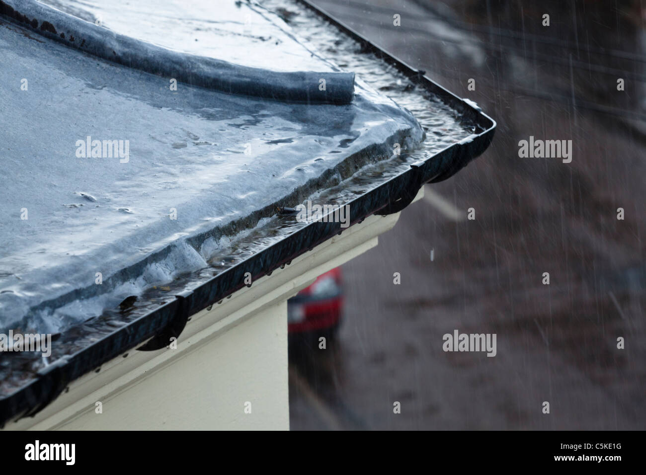 Wet Weather Heavy Rain Falling On A Roof And Into