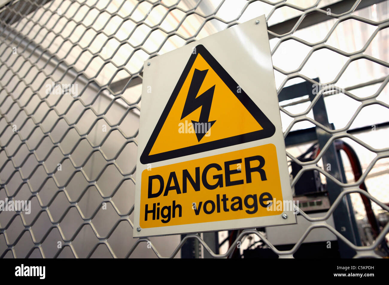Electricity symbol power lightning sign safety warning danger stock warning sign danger high voltage attached to steel mesh fence in a factory buycottarizona Images