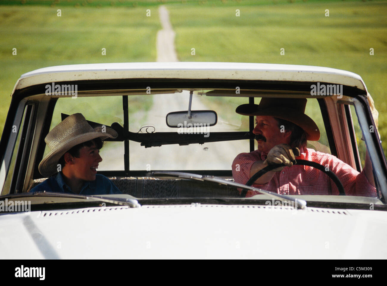 Cowboy And Son Pickup Truck And Gun Rack Montana Stock