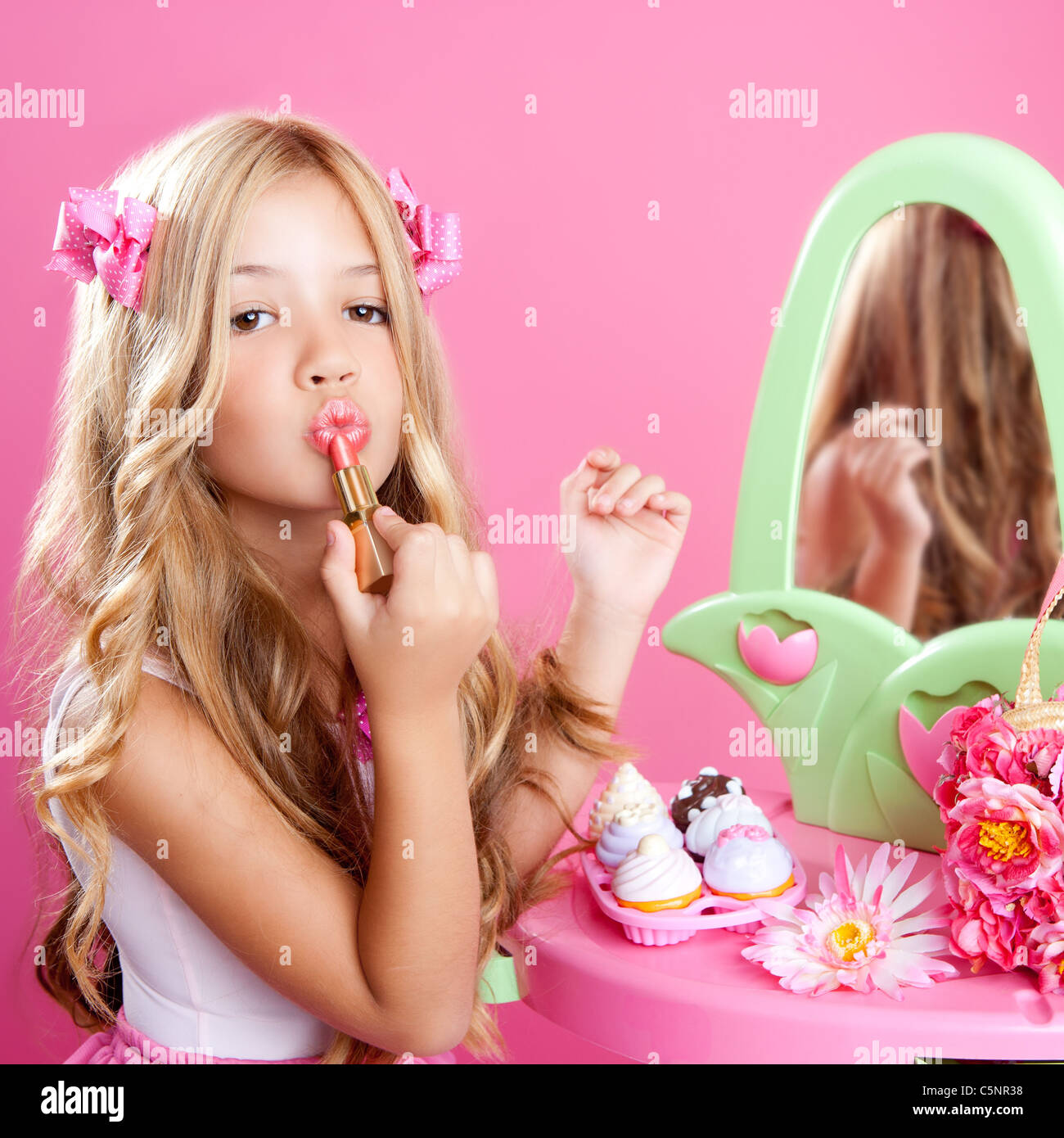 Stock Photo - Children Fashion Doll Little Girl Lipstick Makeup In Pink  Vanity With Mirror