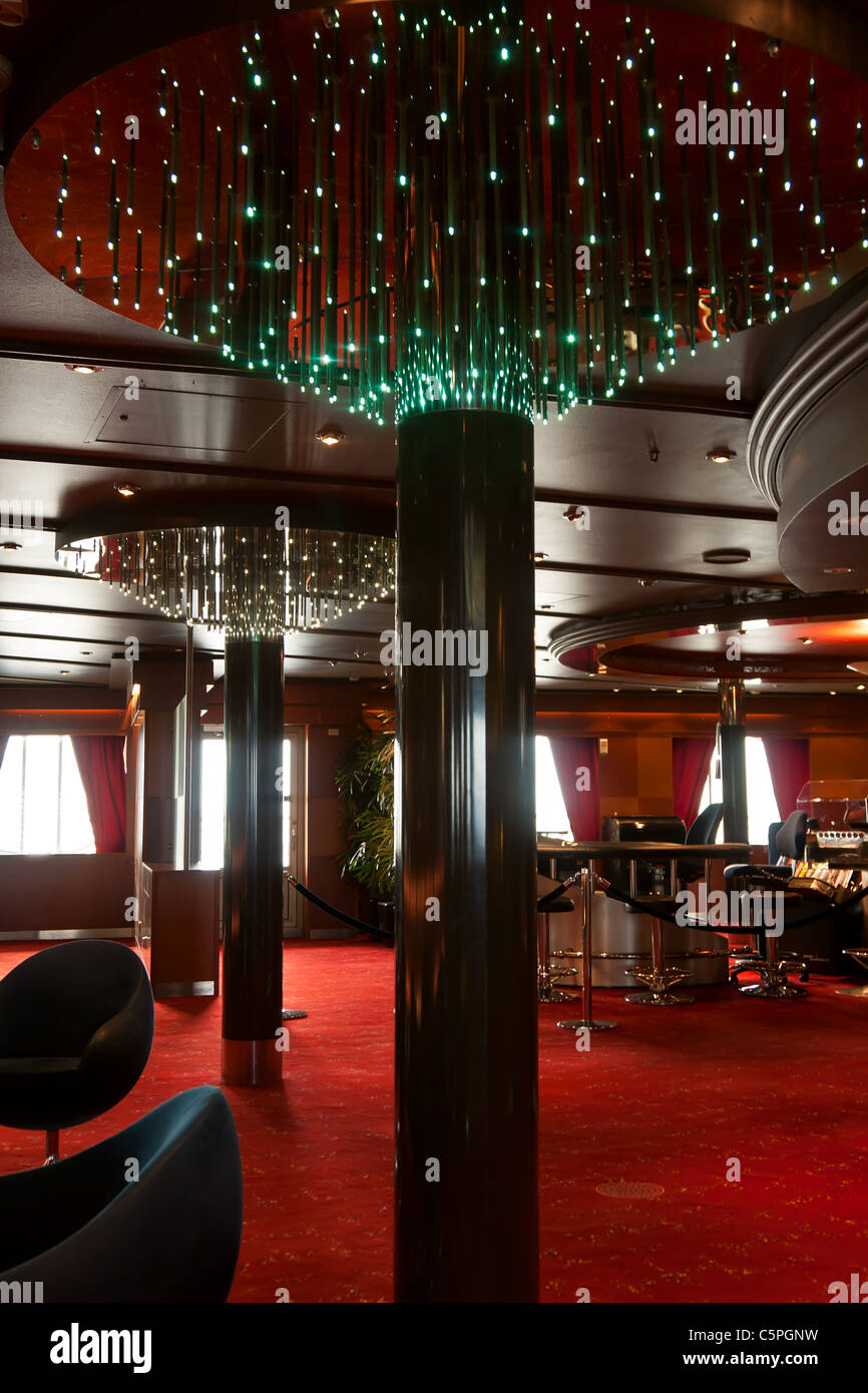 ship interior restaurant with a red carpet stock photo, royalty