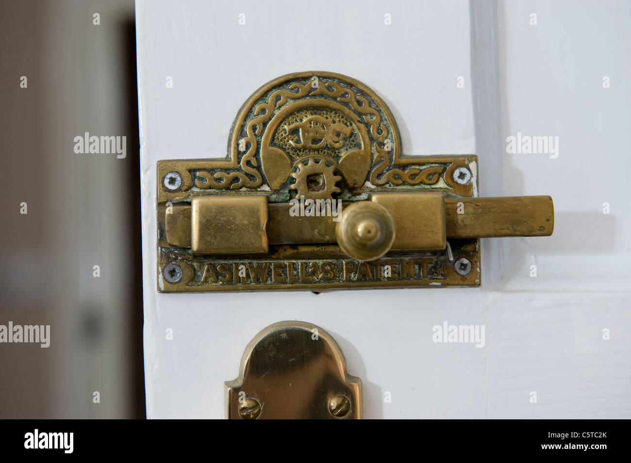 "Bathroom Door Signs Vacant antique brass bathroom door lock and ""vacant"" sign stock photo"