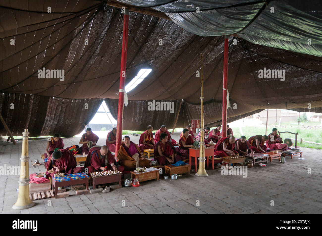 Tibetan Buddhist monks pray in summer time horse hair tent Arou Ba Temple Qilian Qinghai Province China & Tibetan Buddhist monks pray in summer time horse hair tent Arou ...