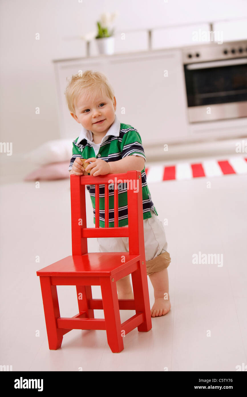 Baby Boy 1 2 Standing Behind Red Chair Stock Photo