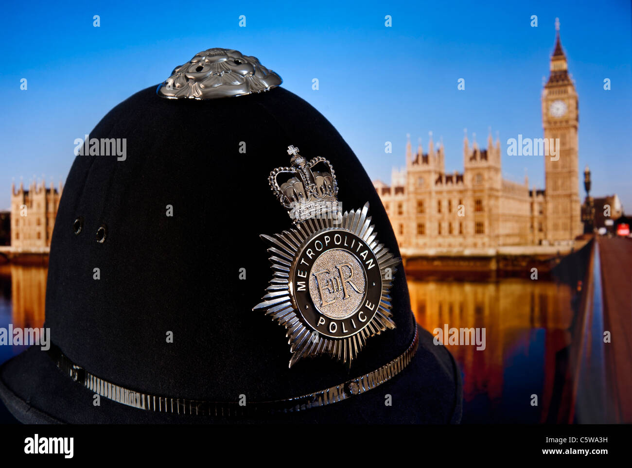 metropolitan police helmet and badge with houses of parliament and