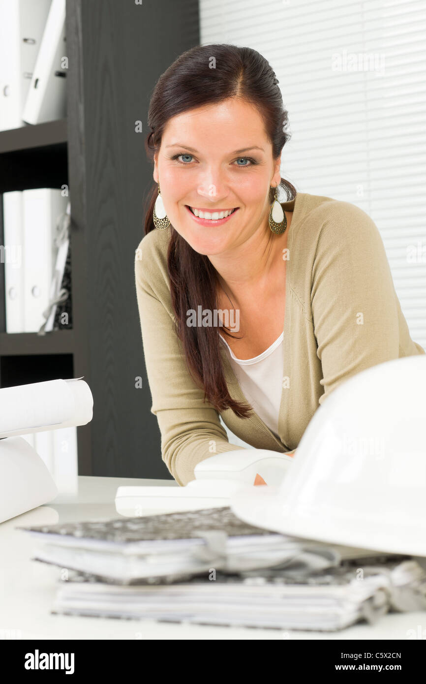 office relaxation. office relaxation pose professional architect woman leaning over table