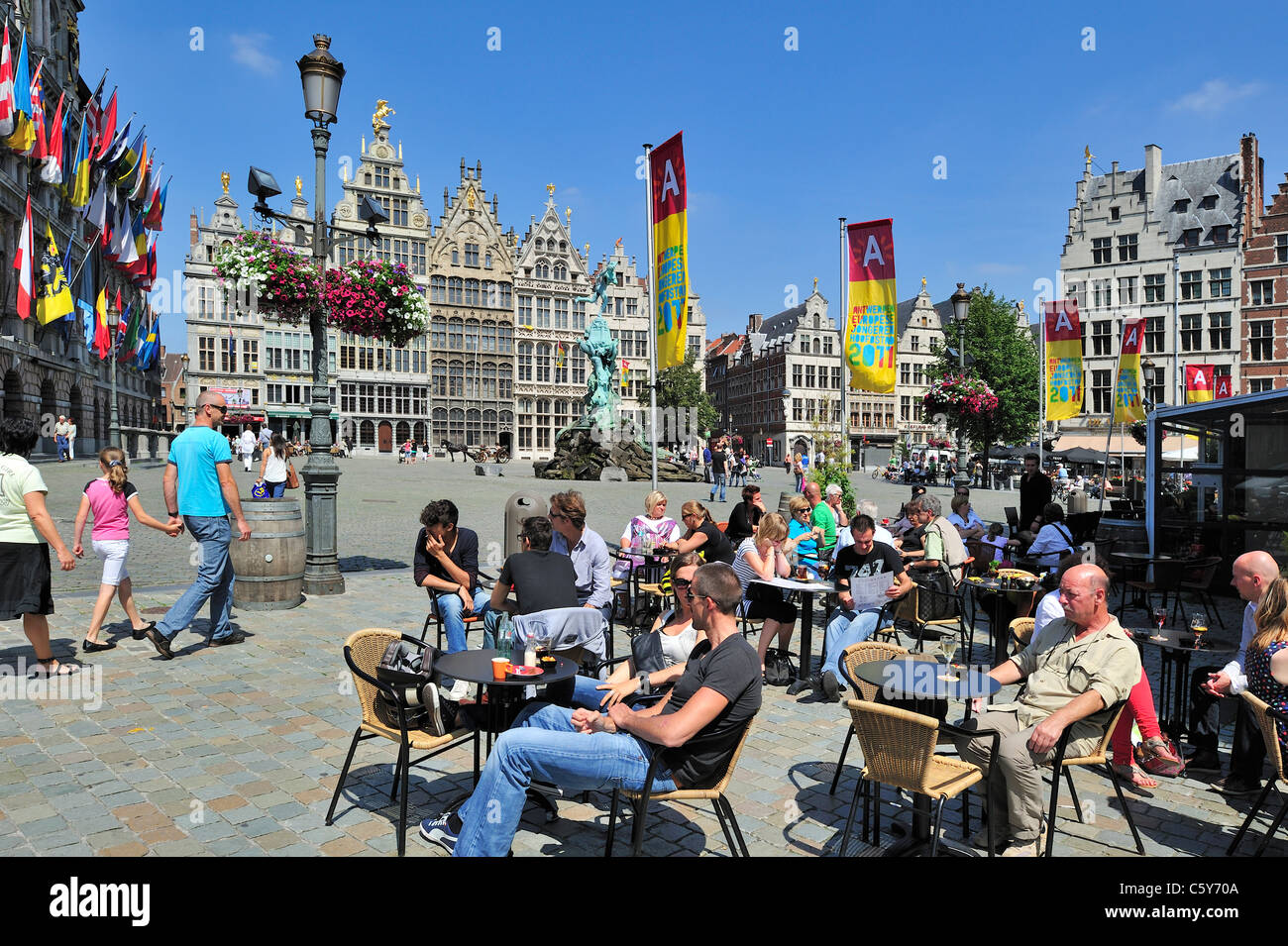 Tt Markt tourists sitting on terrace of pavement café on the grote markt