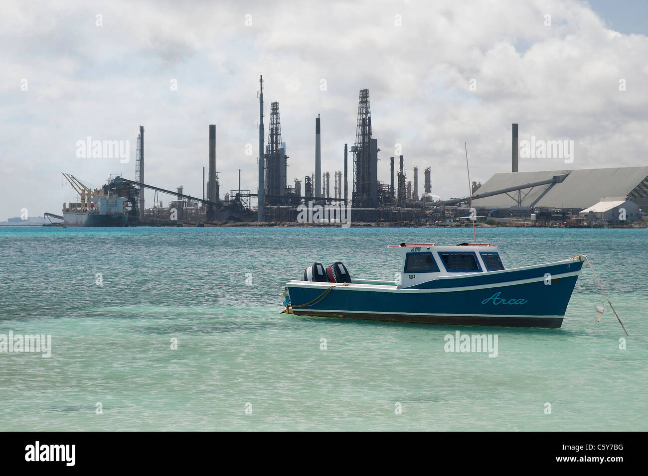 Fishing Boat in a bay with the Valero Oil Refinery in the ...