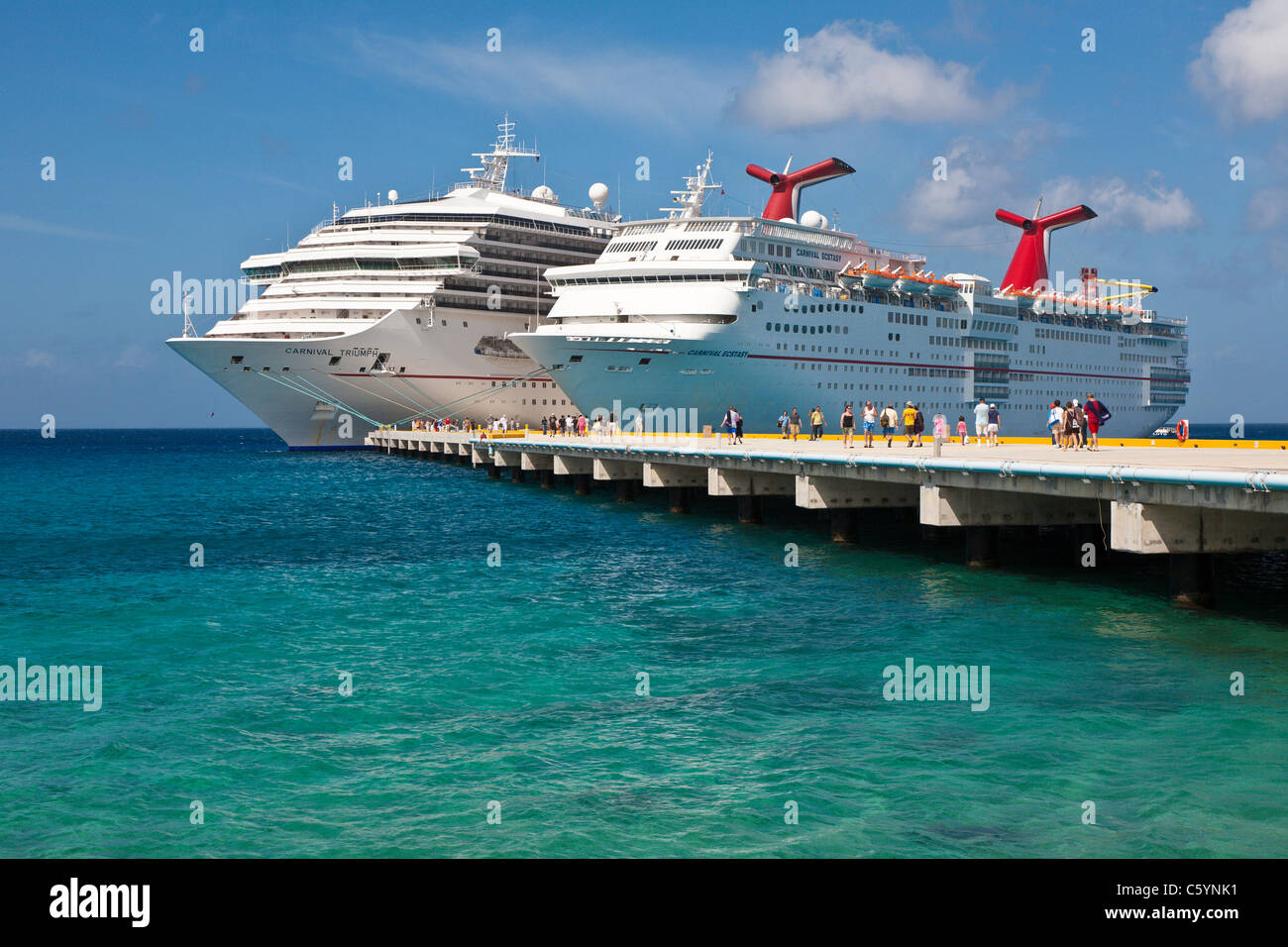 Cruise Ship Passengers On Pier Disembarking From Carnival Cruise Stock Photo