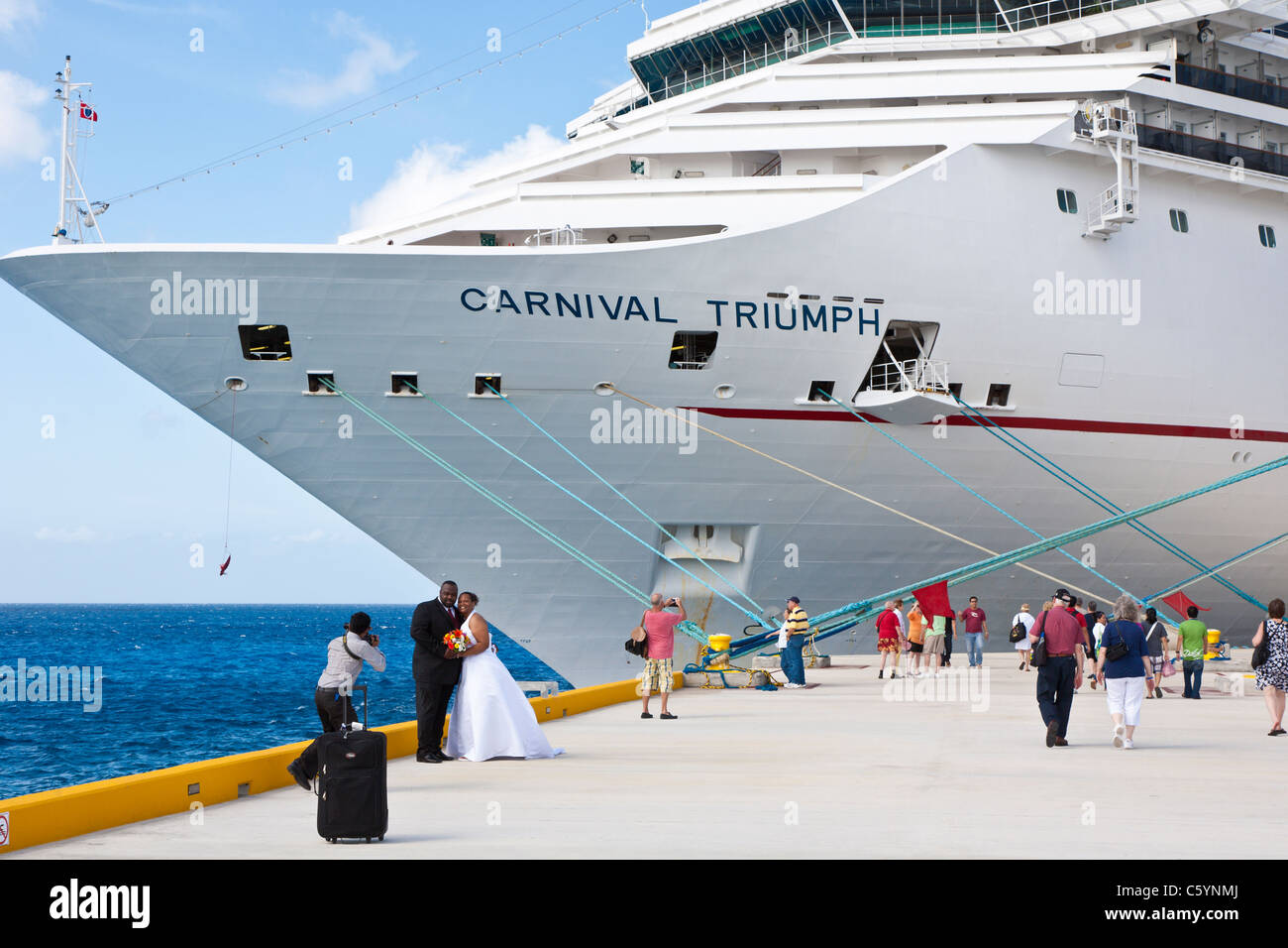 wedding photographer photographing newly married black couple in front of carnival triumph cruise ship in cozumel mexico - Cruise Ship Photographer