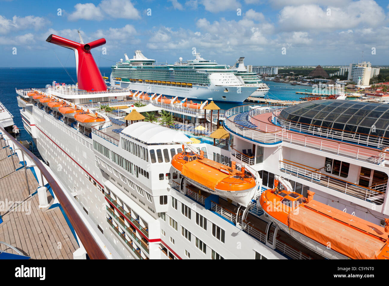 carnival ecstasy and two royal caribbean cruise ships at port in