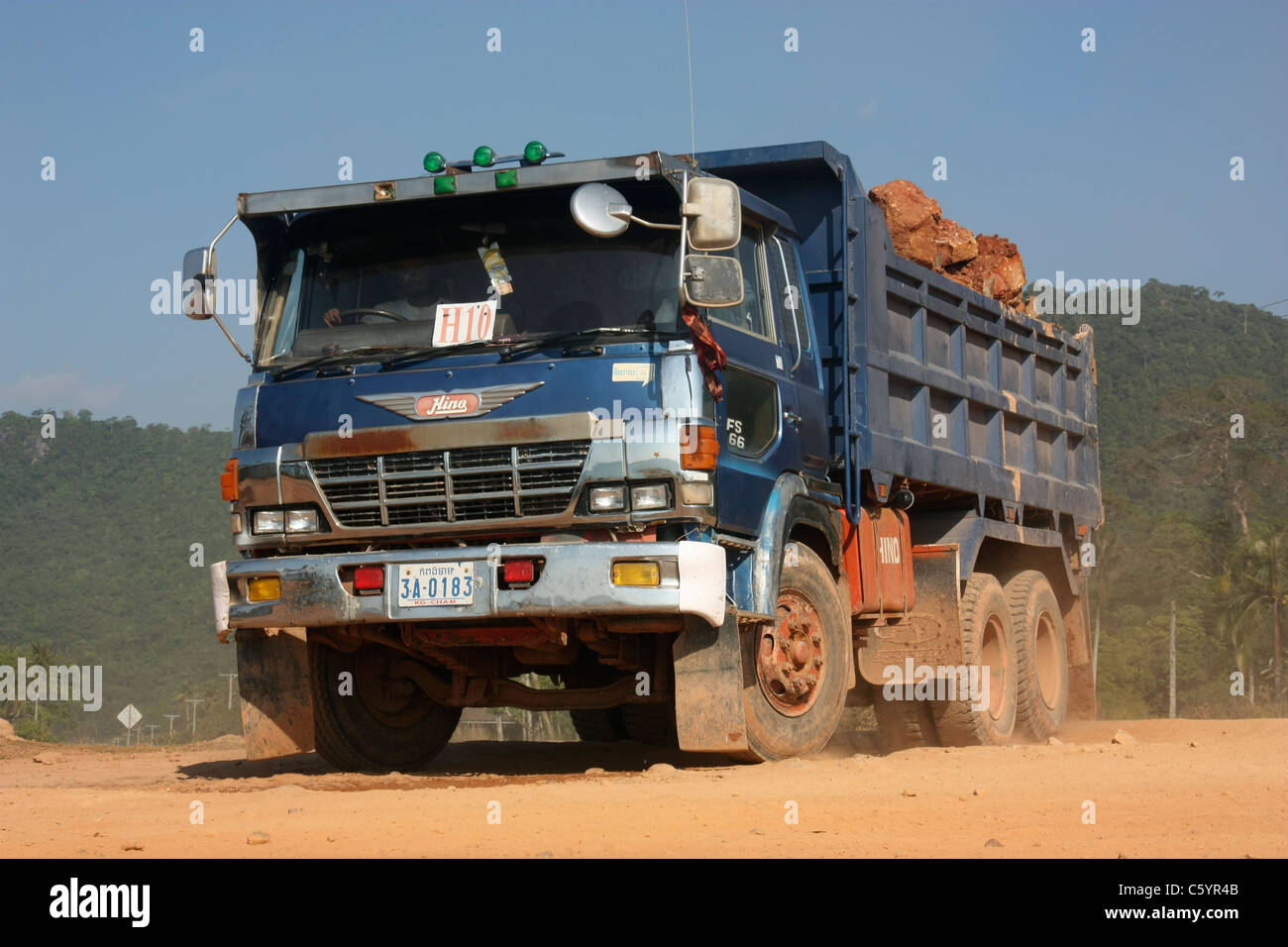 japanese manufactured hino fs66 dump truck during road construction work in southern cambodia stock photo