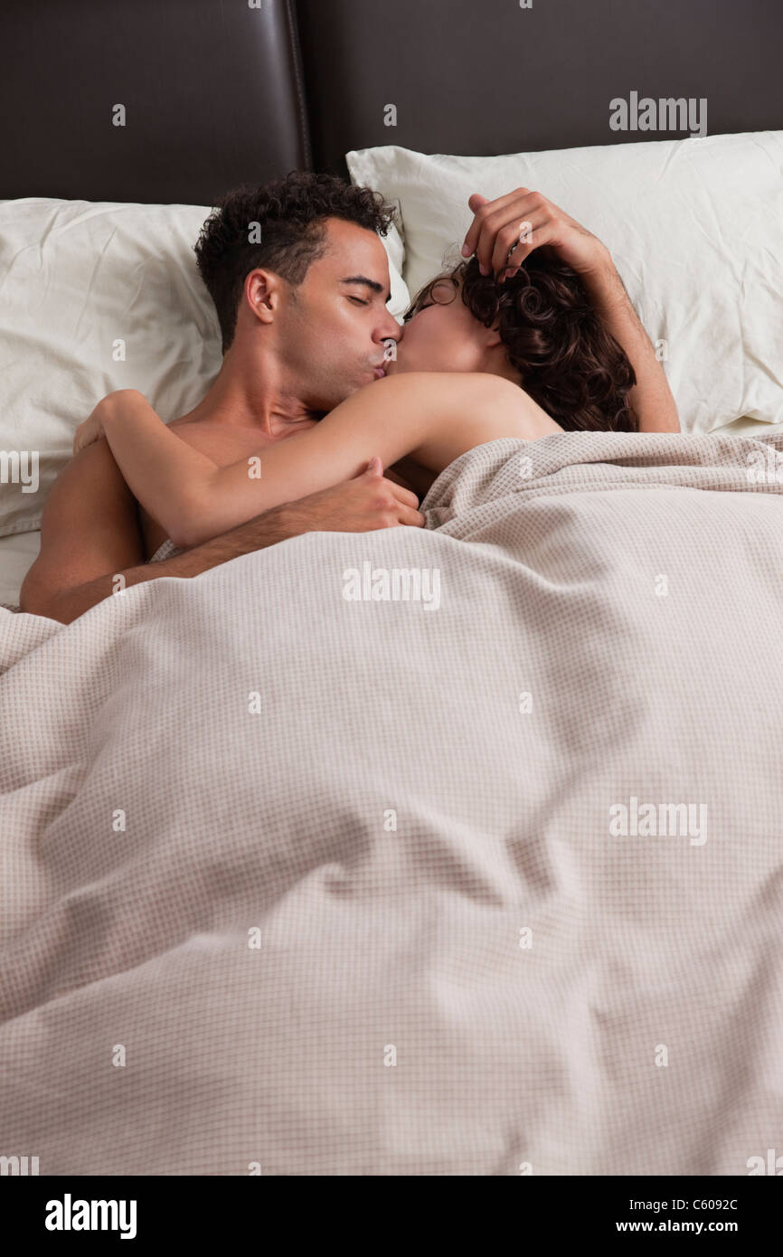 Picture Of Couple Kissing In Bed