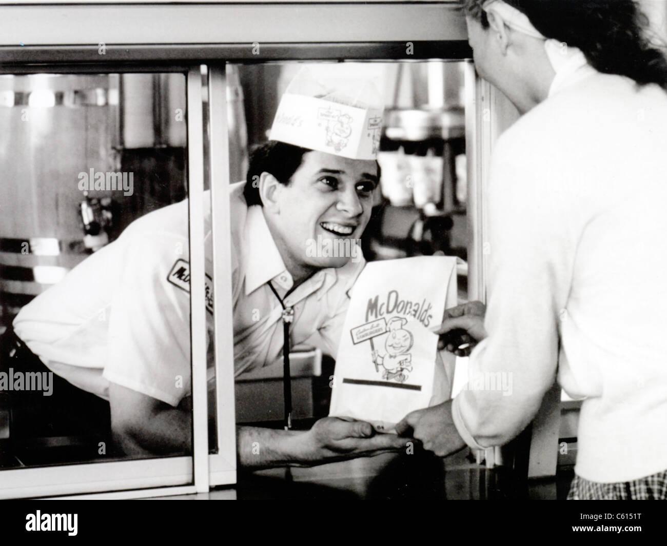 mcdonald s restaurant crew member at the window handing a customer mcdonald s restaurant crew member at the window handing a customer a bag 1950s mcdonald s