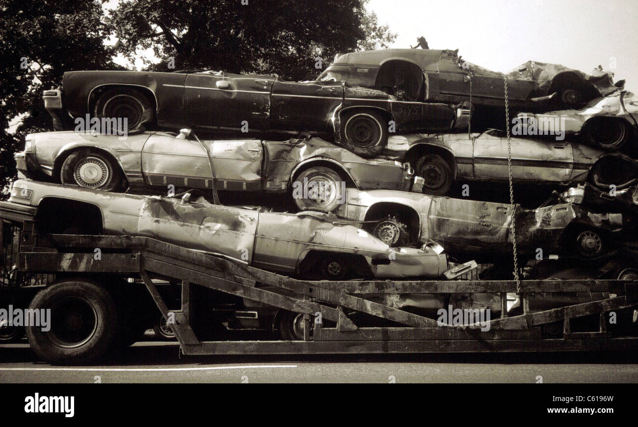 Junked cars being transported for use a scrap metal in New York ...