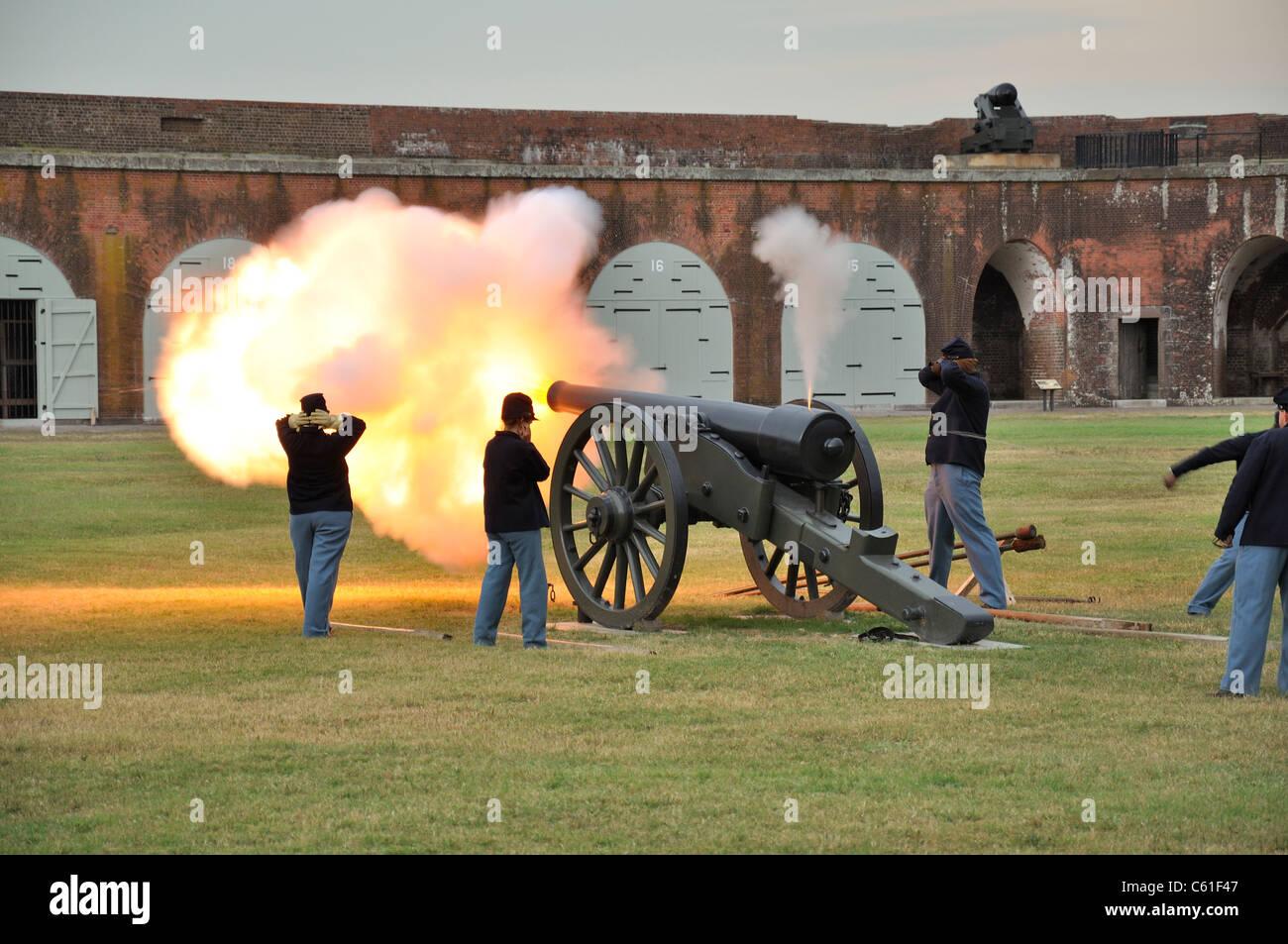 Civil war reenactment soldiers fire cannons at fort pulaski national monument near savannah georgia