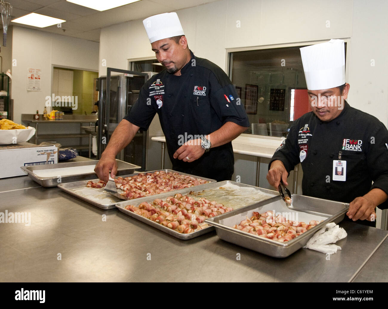 Chefs work in the kitchen of the San Antonio Food Bank in San