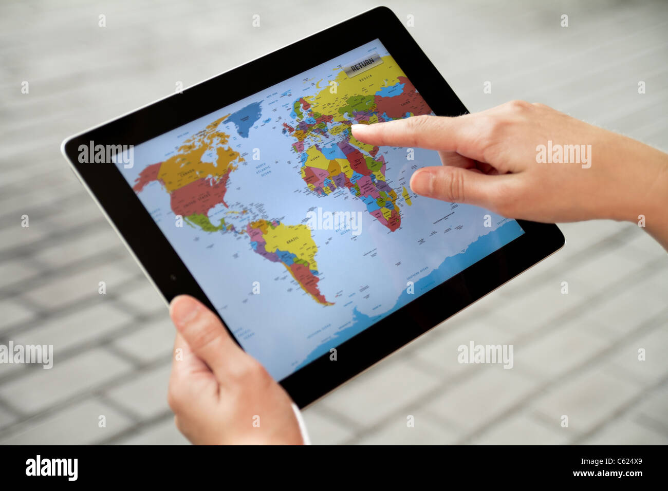 A woman using application with world map on apple ipad2 stock a woman using application with world map on apple ipad2 gumiabroncs Gallery