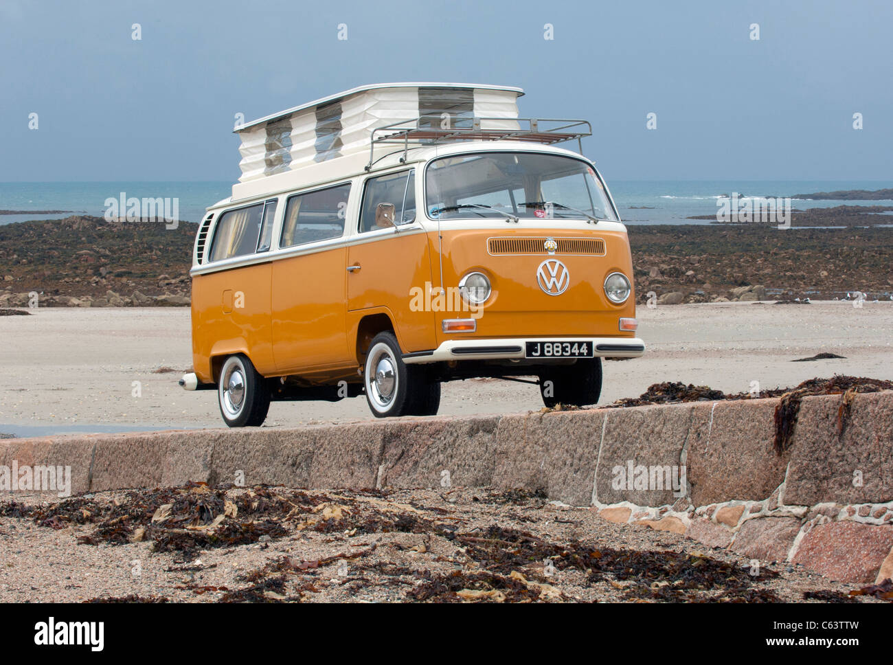 Stock Photo - VW Volkswagen Bay Window Devon Cu0026er Van Classic Air Cooled Rear Engined Van Pop Up Roof Raised Beach Orange White & Roof Camper u0026