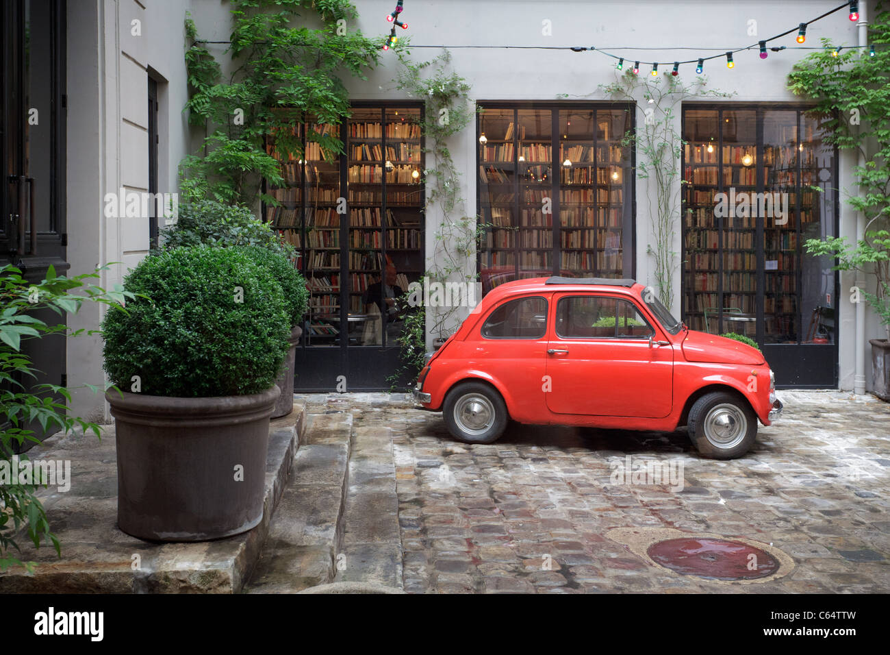 Red Fiat 500 car in courtyard outside Paris concept store, Merci ...