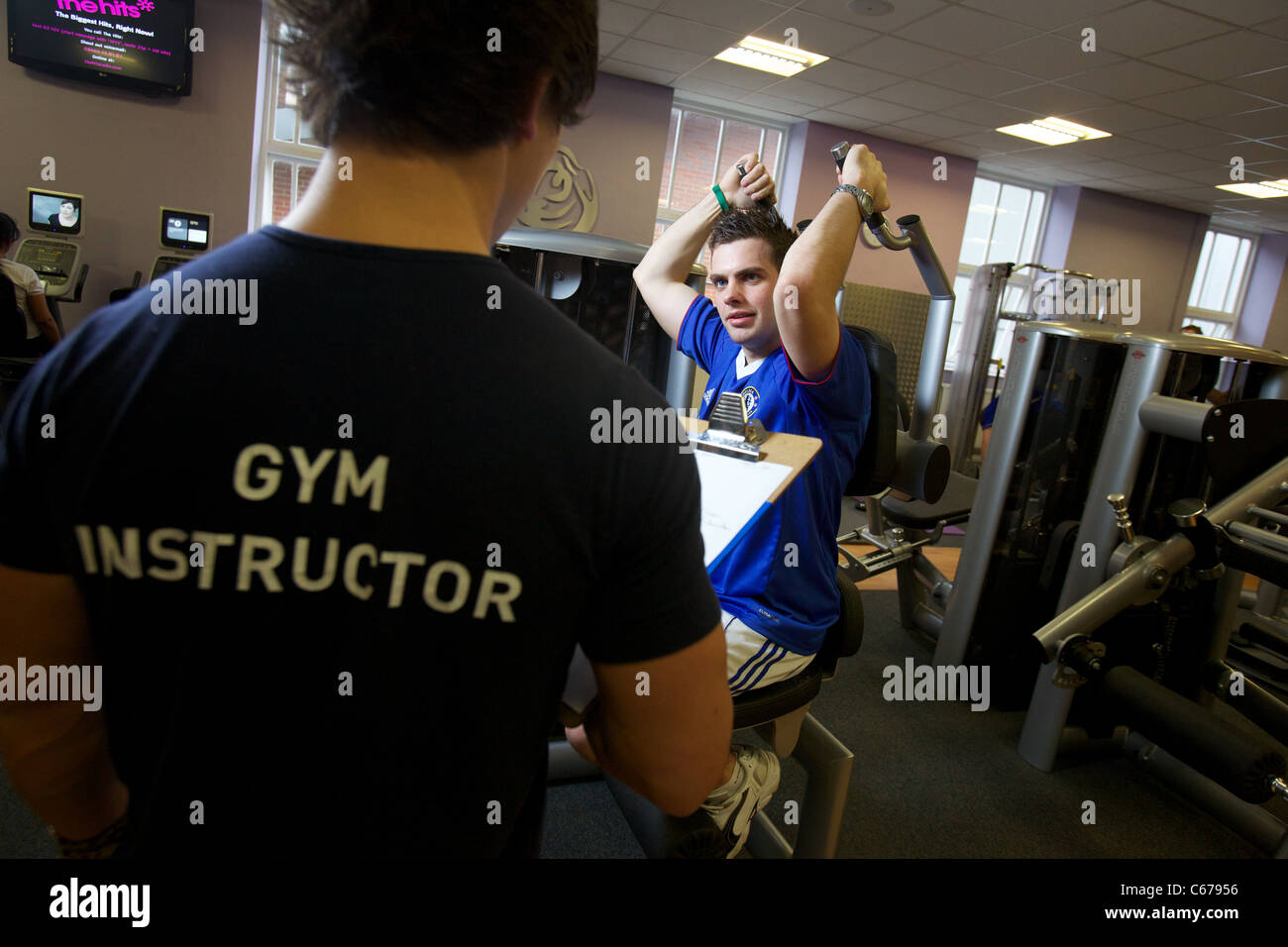 Gym Instructor Conducting A Gym Assessment On An Indoor Body ...