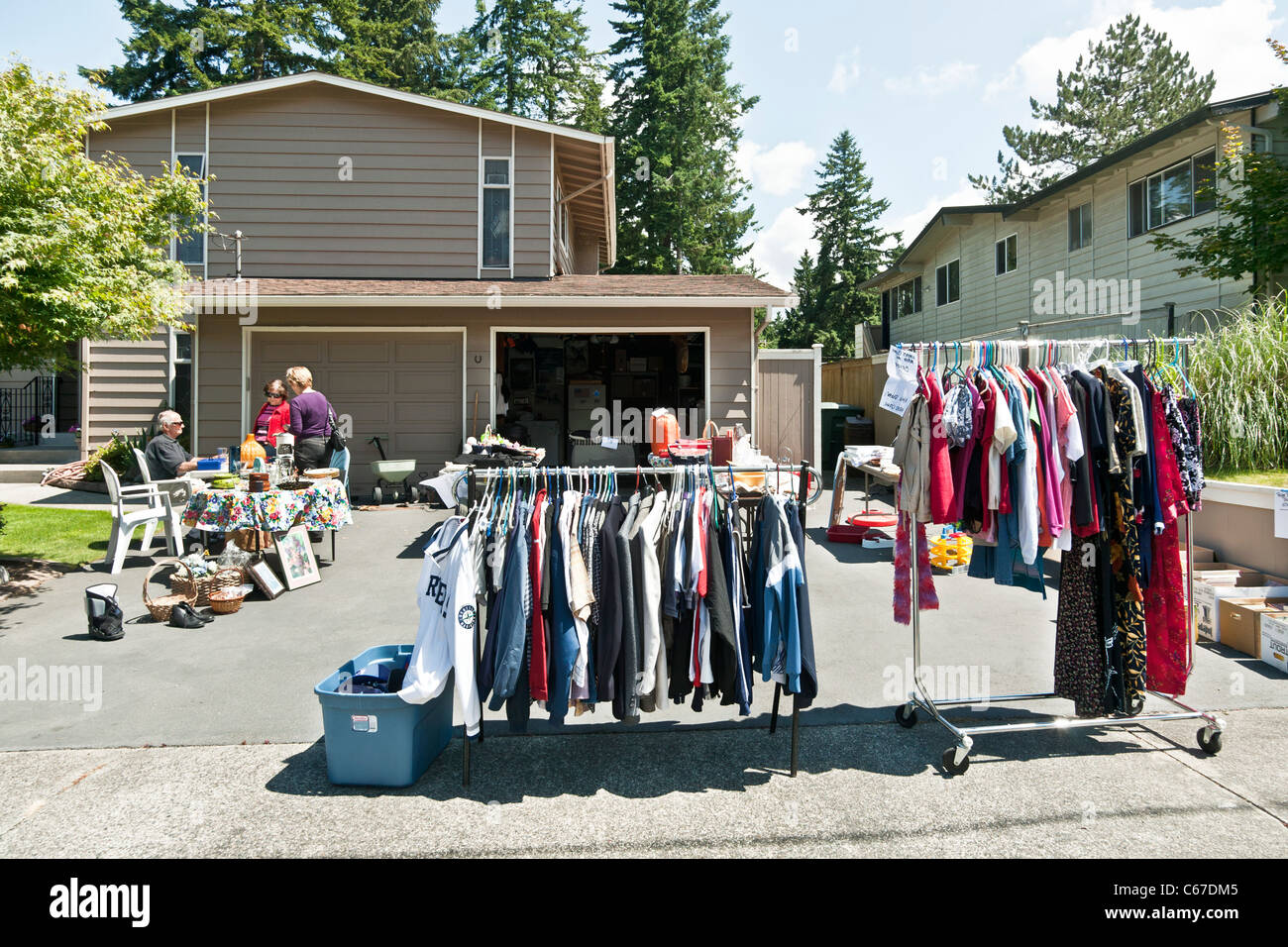 Garage Yard Sale Used Clothes Artwork Dishes Bric A Brac Kitsch In Driveway Outside Suburban House Edmonds Washington