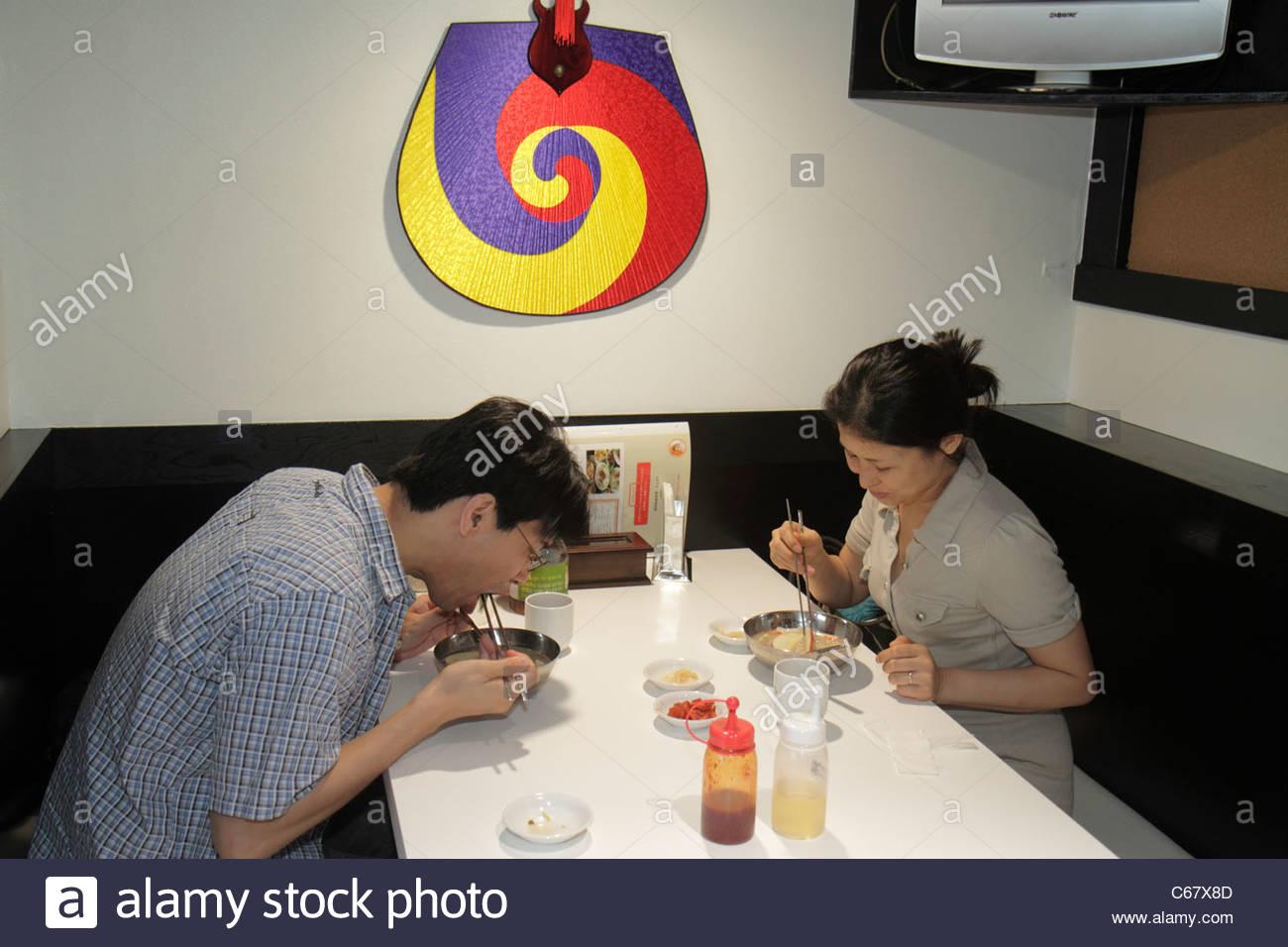 Tokyo japan ikebukuro restaurant interior asian man woman for Japanese eating table