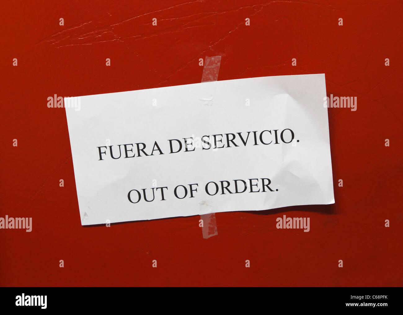 spanish and english bi lingual sign saying fuera de
