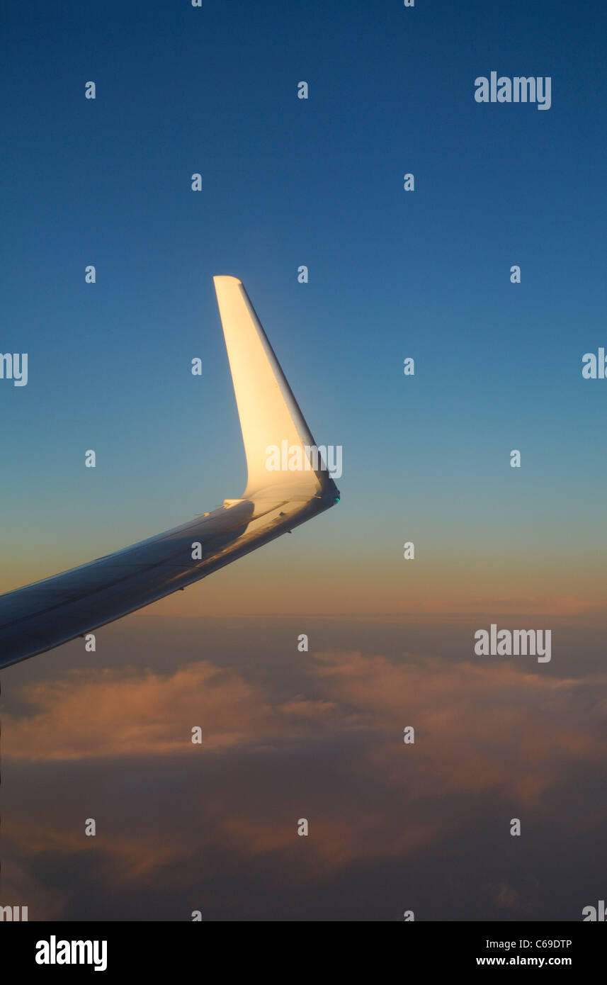 Wing tip of boeing 737 800 airliner plane at sunset over atlantic wing tip of boeing 737 800 airliner plane at sunset over atlantic ocean buycottarizona Image collections