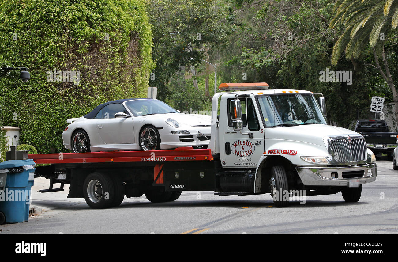 A tow truck tows victoria beckham s signature porsche from her home in beverly hills los angeles california 02 10 09