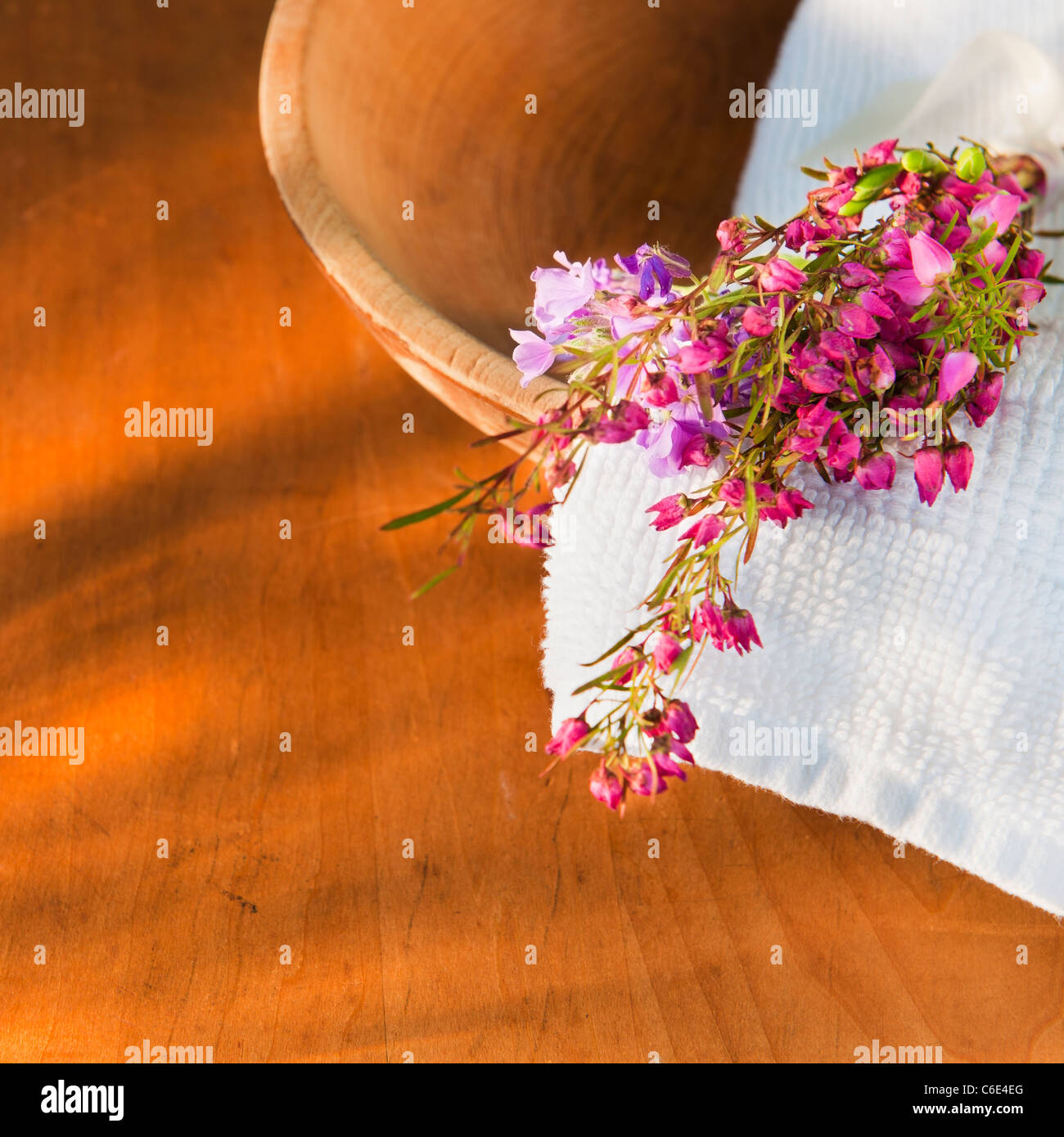 Still life with purple flowers towel and wooden bowl stock photo still life with purple flowers towel and wooden bowl izmirmasajfo
