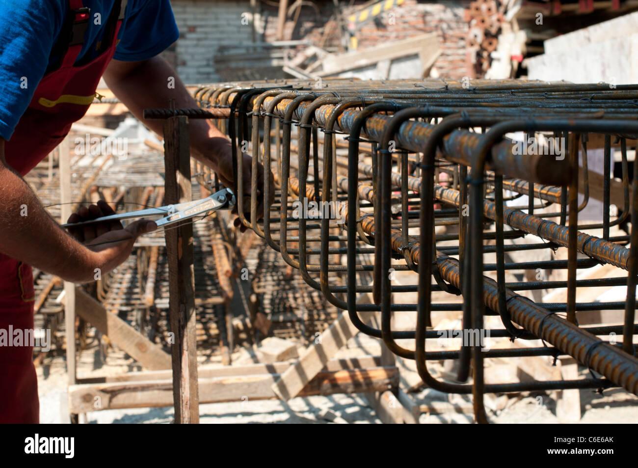 construction worker ties reinforcing steel rebar close up