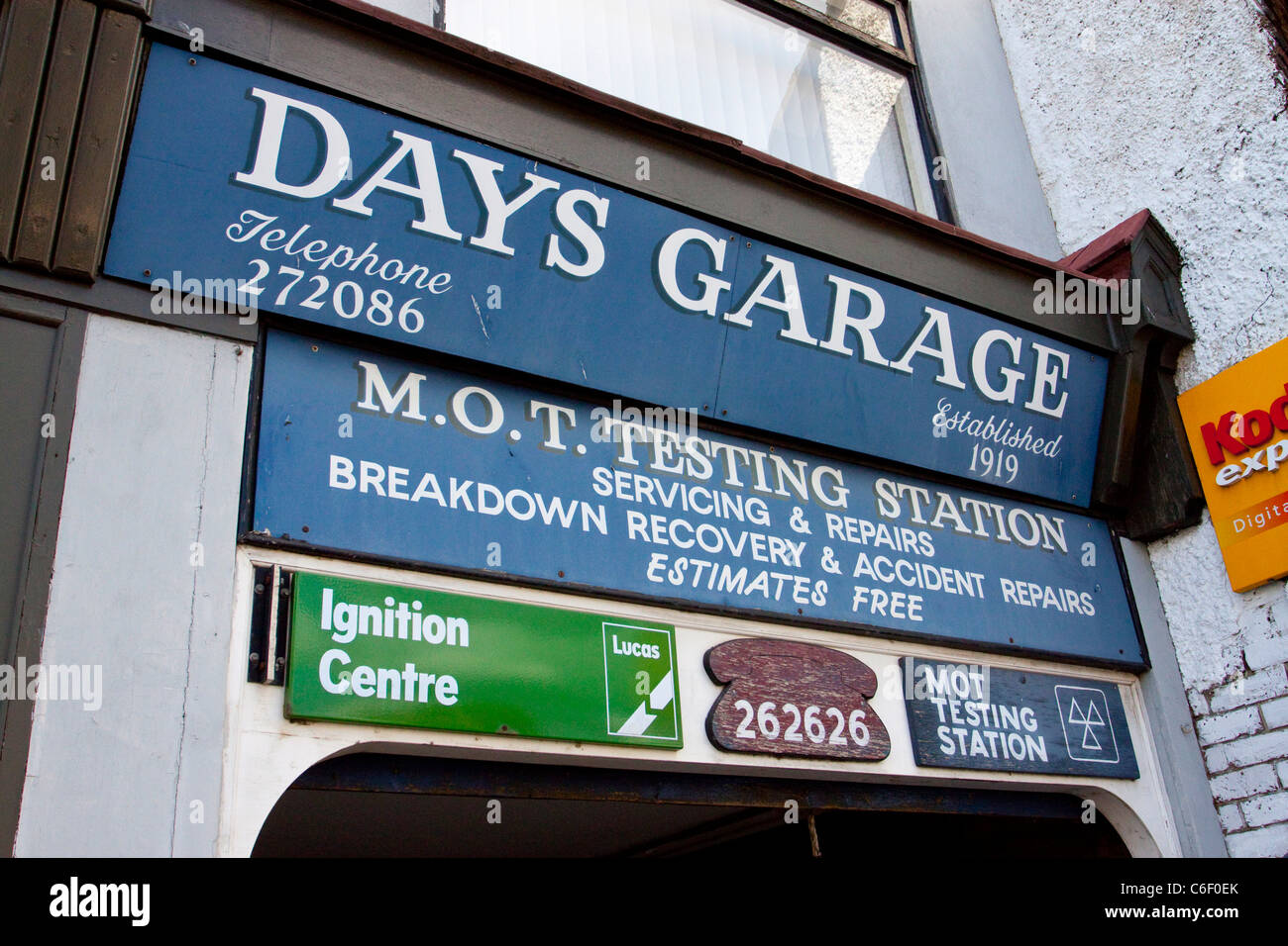 Name board over a traditional garage and service centre in for Garage ad biard