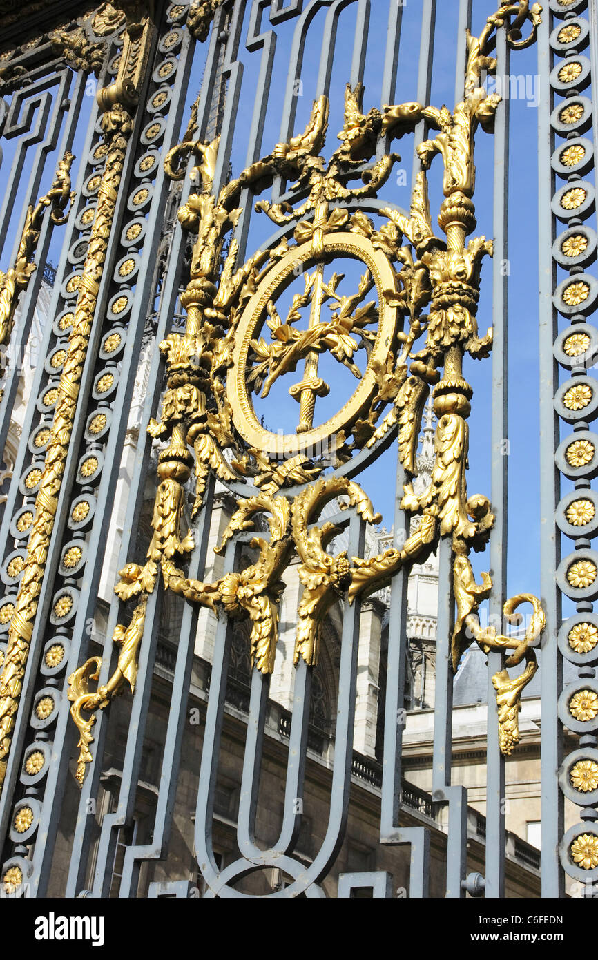 The ornate gilded gates which form the entrance to the Palais de ...