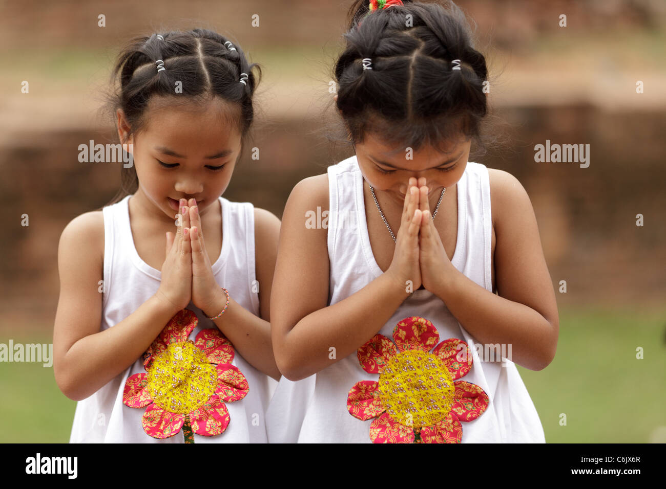 Thai girls welcome stock photos thai girls welcome stock images thai little girls traditional greetings ayuthaya thailand stock image kristyandbryce Images