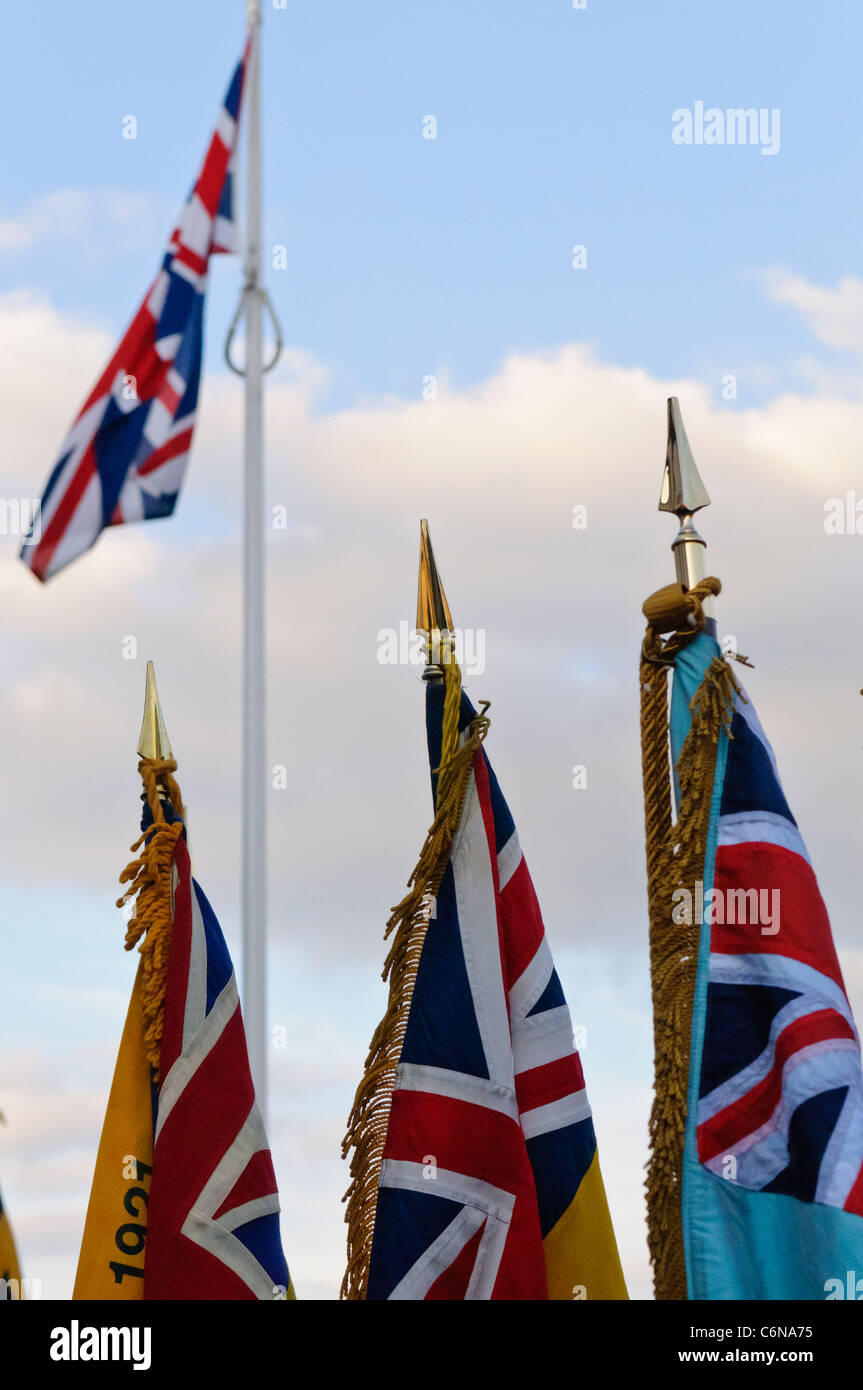 royal british legion flags and standards in front of a union flag
