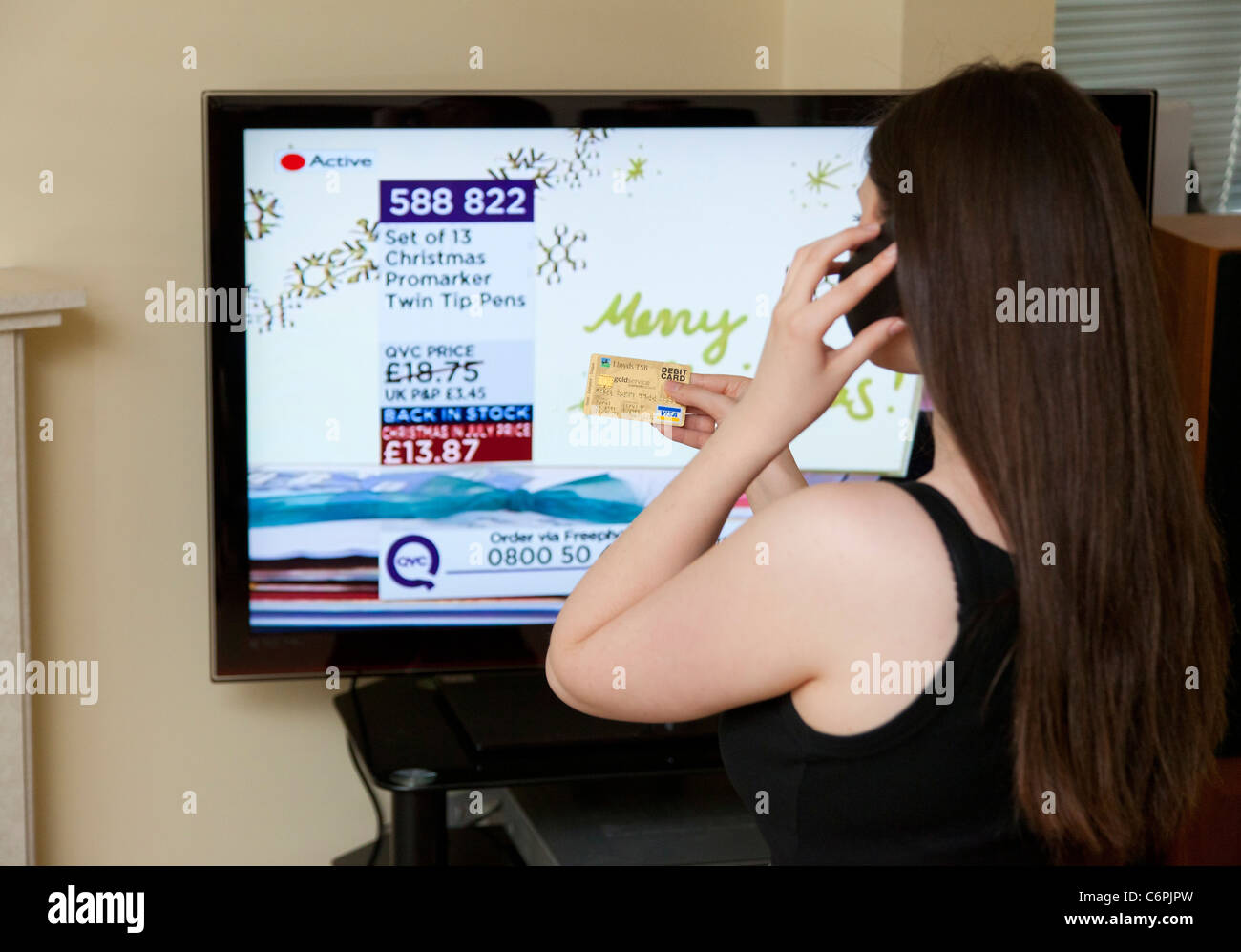 tv qvc. stock photo - woman buying from qvc shopping tv channel tv qvc