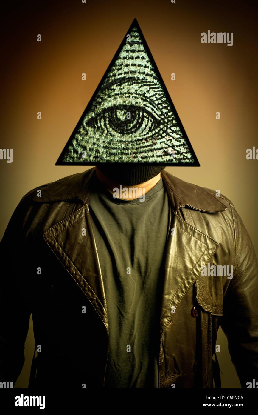 Illuminati stock photos illuminati stock images alamy a male figure in a leather trench coat wearing an illuminati symbol eye of providence biocorpaavc