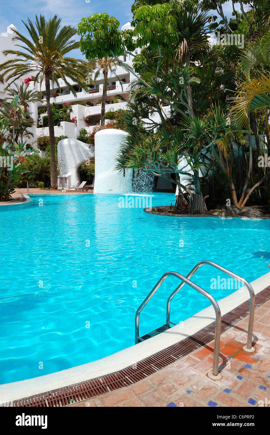 Swimming pool with waterfall and building of luxury hotel for Swimming pool waterfalls construction