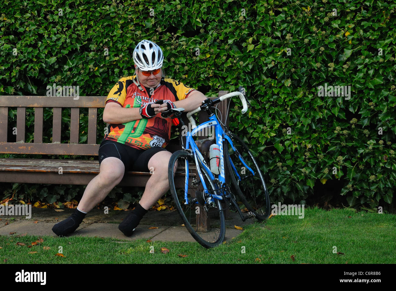 obese-cyclist-having-a-rest-and-using-mo