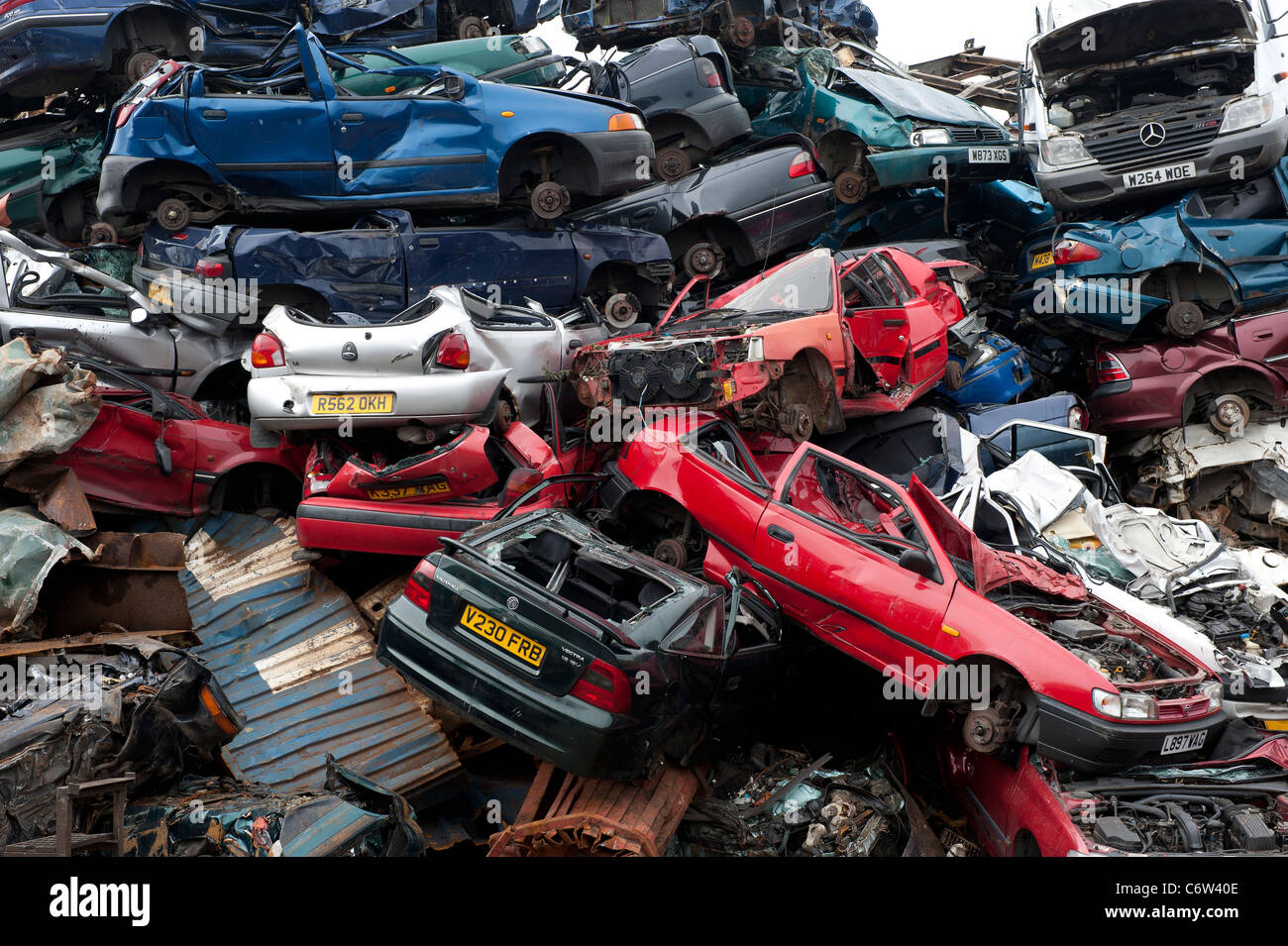 Crushed cars in scrap metal recycling yard in Malta Stock Photo ...