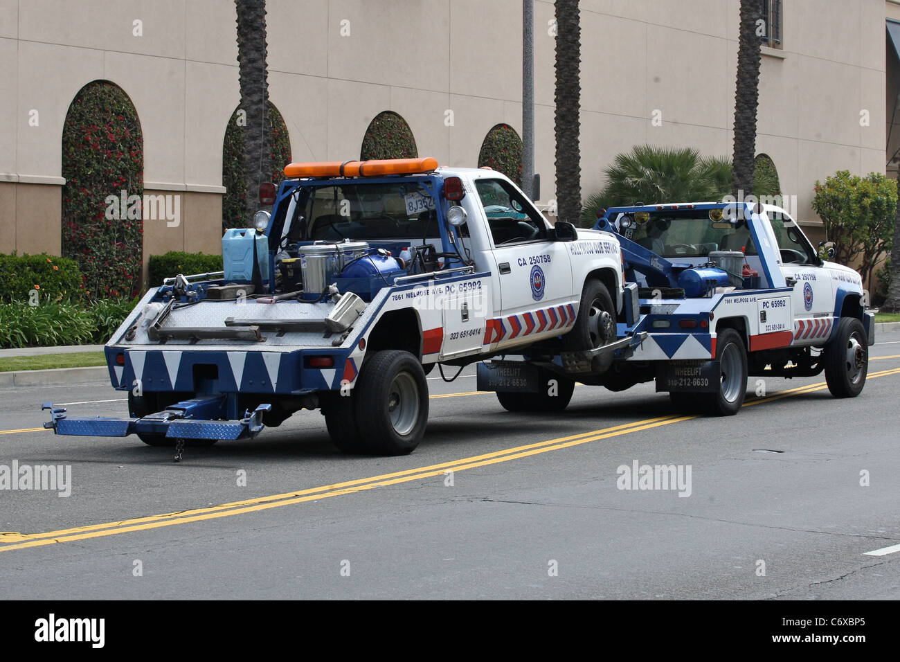 Stock photo tow truck gets towed this tow truck needed a lift after breaking down in los angeles ironically the vehicle was pulled by