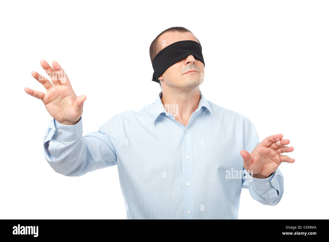 businessman-blindfolded-stretching-his-a