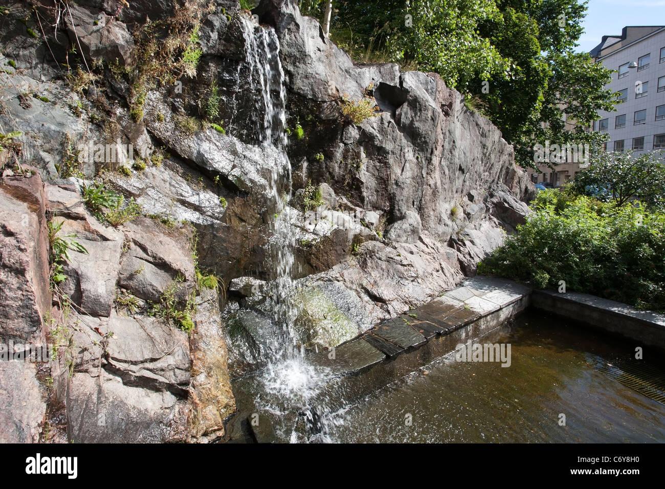small waterfall fountain in city park in kallio helsinki finland - Waterfall Fountain