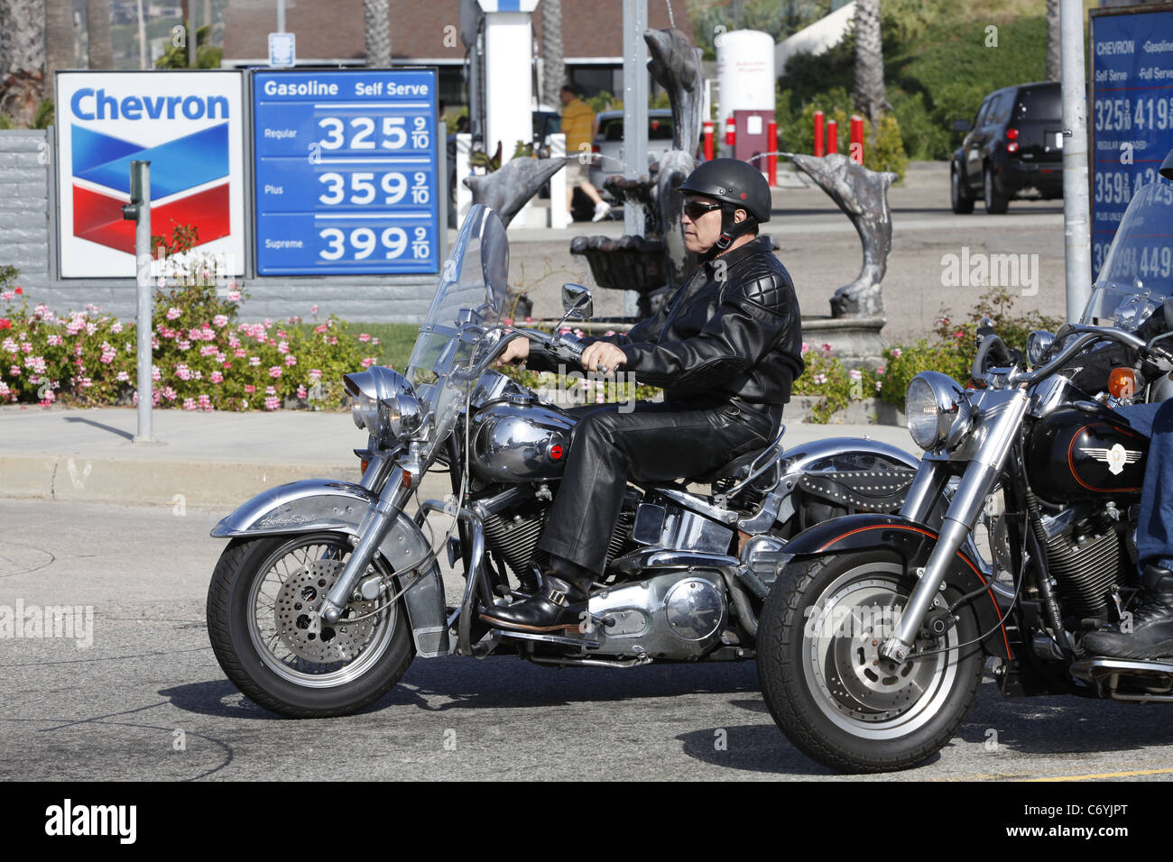 arnold schwarzenegger riding his cromed harley davidson to malibu
