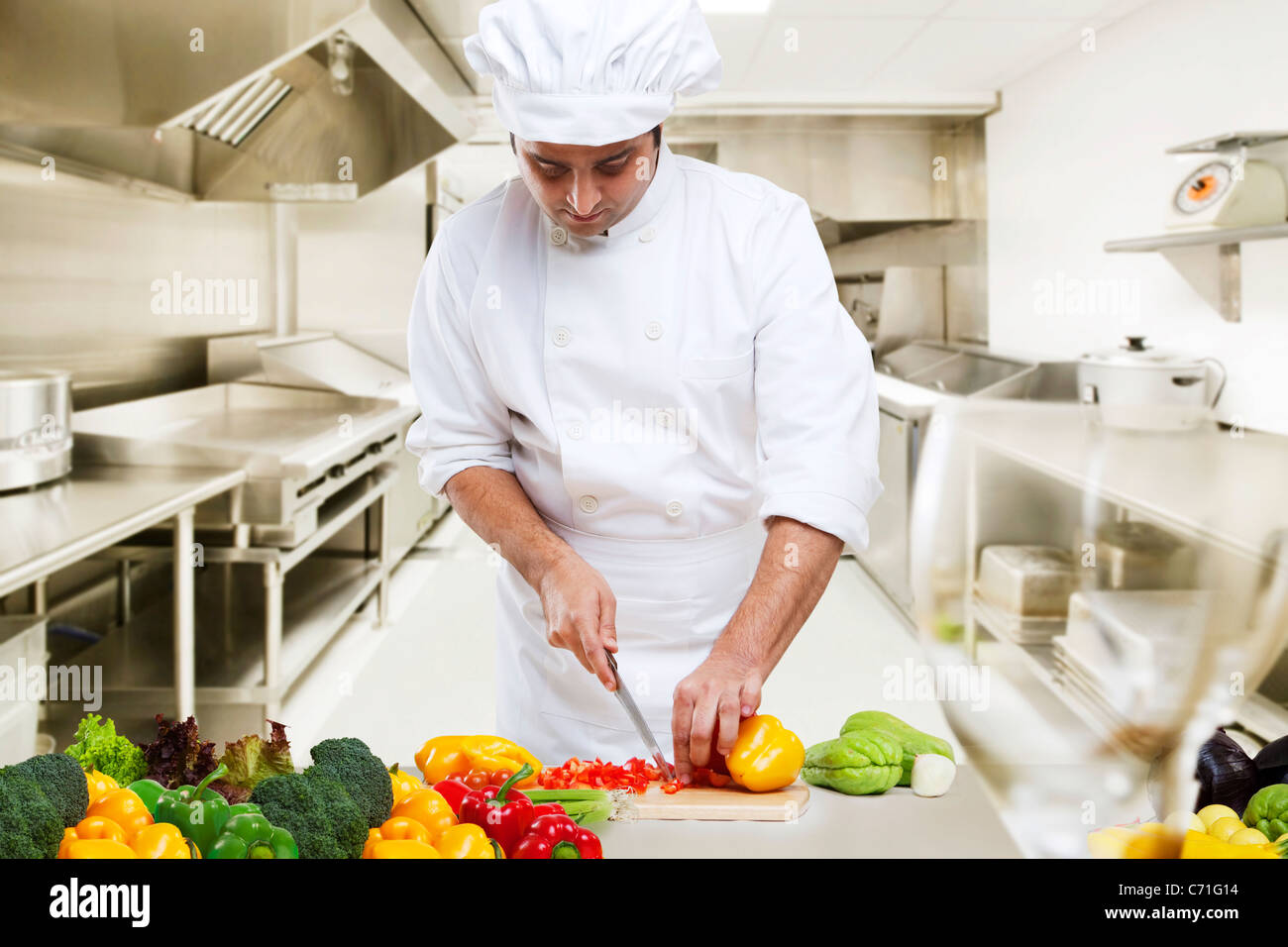 Chef cutting vegetables in the kitchen Stock Photo ...