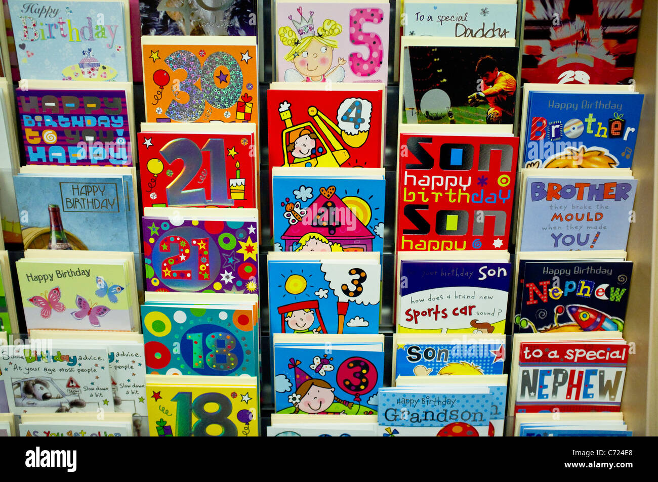 A variety of brightly coloured birthday cards on a shop display – Birthdays Card Shop Uk