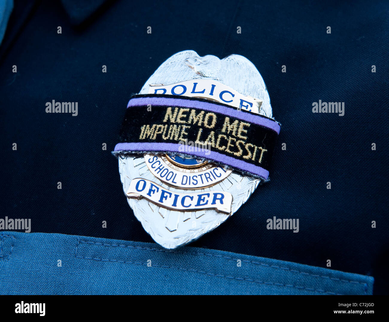 police officer badge with a banner that reads