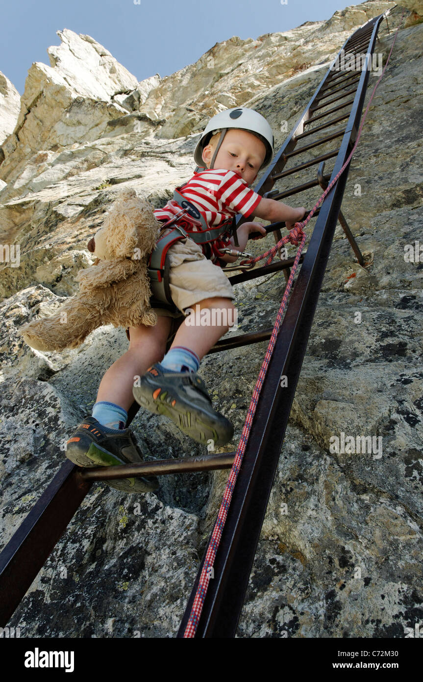 A Young Boy Climbing Down The Ladders At The Pas De Chevres, Arolla,  Switzerland  The Ladders