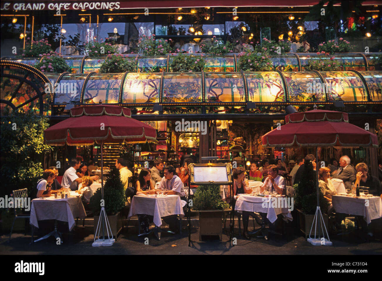 Grand Cafe Capucines in the evening light, typically French Stock ...